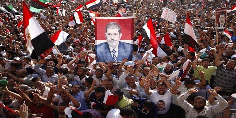 Supporters of Muslim Brotherhood's presidential candidate Morsy celebrate his victory at the election at Tahrir Square in Cairo